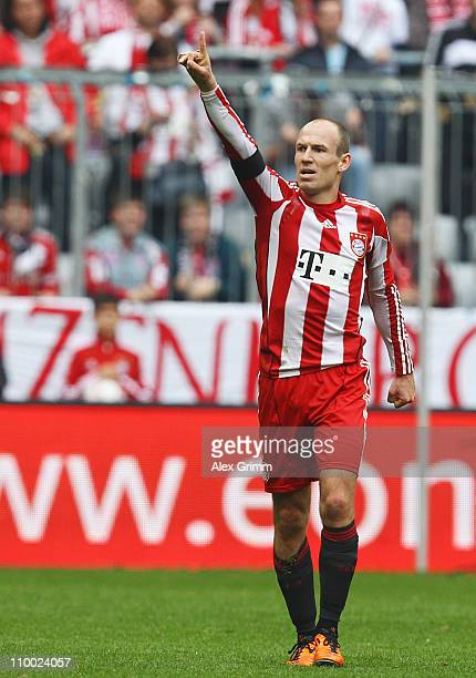 Arjen Robben of Muenchen celebrates his team's first goal during the Bundesliga match between FC Bayern Muenchen and Hamburger SV at Allianz Arena on...
