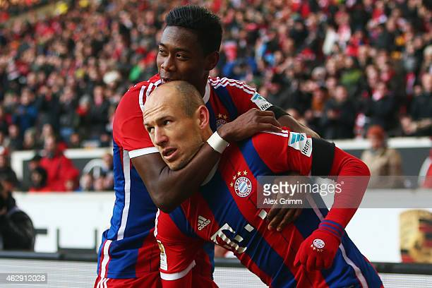 Arjen Robben of Muenchen celebrates his team's first goal with team mate David Alaba during the Bundesliga match between VfB Stuttgart and FC Bayern...