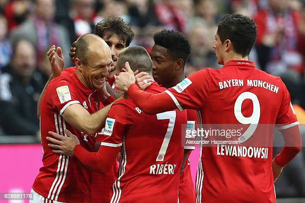 Arjen Robben of Muenchen celebrates his team's first goal with team mates during the Bundesliga match between Bayern Muenchen and VfL Wolfsburg at...