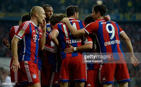 Arjen Robben of Muenchen celebrates his team's second goal with team mates during the Bundesliga match between FC Bayern Muenchen and Borussia...