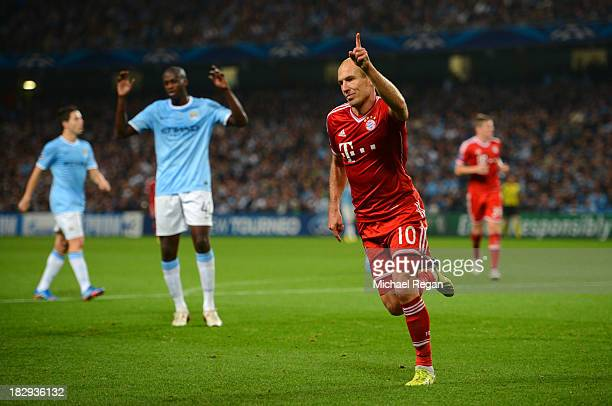 Arjen Robben of Muenchen celebrates his team's third goal during the UEFA Champions League Group D match between Manchester City and FC Bayern...