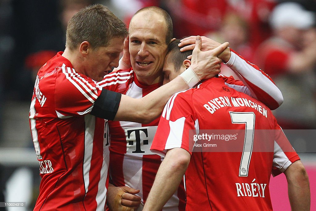 Arjen Robben (C) of Muenchen celebrates his team's third goal with team mates Bastian Schweinsteiger (L) and Franck Ribery during the Bundesliga match between FC Bayern Muenchen and Hamburger SV at Allianz Arena on March 12, 2011 in Munich, Germany.