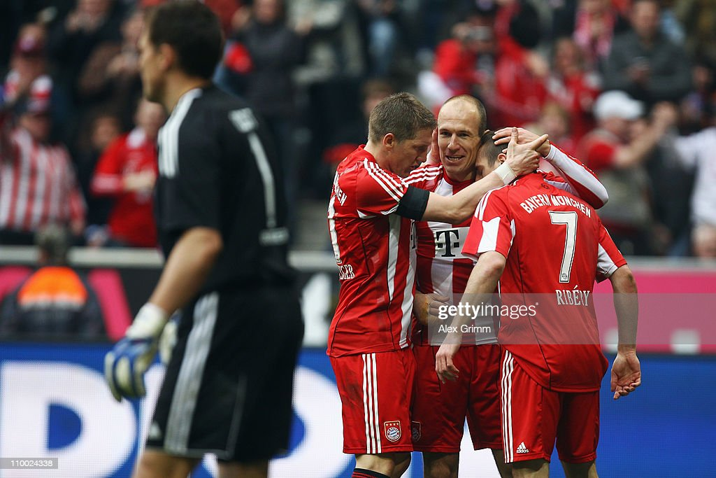 <a gi-track='captionPersonalityLinkClicked' href=/galleries/search?phrase=Arjen+Robben&family=editorial&specificpeople=194740 ng-click='$event.stopPropagation()'>Arjen Robben</a> (2R) of Muenchen celebrates his team's third goal with team mates <a gi-track='captionPersonalityLinkClicked' href=/galleries/search?phrase=Bastian+Schweinsteiger&family=editorial&specificpeople=203122 ng-click='$event.stopPropagation()'>Bastian Schweinsteiger</a> (2L) and <a gi-track='captionPersonalityLinkClicked' href=/galleries/search?phrase=Franck+Ribery&family=editorial&specificpeople=490869 ng-click='$event.stopPropagation()'>Franck Ribery</a> (R) as goalkeeper <a gi-track='captionPersonalityLinkClicked' href=/galleries/search?phrase=Frank+Rost&family=editorial&specificpeople=204339 ng-click='$event.stopPropagation()'>Frank Rost</a> of Hamburg reacts during the Bundesliga match between FC Bayern Muenchen and Hamburger SV at Allianz Arena on March 12, 2011 in Munich, Germany.