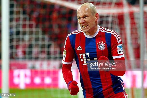 Arjen Robben of Muenchen celebrates scoring his team's third goal during the Bundesliga match between FC Bayern Muenchen and 1 FC Koeln at Allianz...