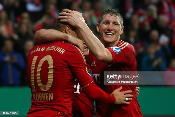Arjen Robben of Muenchen celebrates scoring the 2nd team goal with his team mates Xherdan Shaqiri and Bastian Schweinsteiger during the DFB Cup Semi...