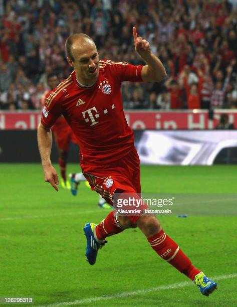 Arjen Robben of Muenchen celebrates scoring the 3rd team goal during the Bundesliga match between FC Bayern Muenchen and Bayer 04 Leverkusen at...