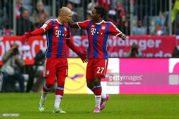 Arjen Robben of Muenchen celebrates scoring the 3rd team goal with his team mate David Alaba during the Bundesliga match between FC Bayern Muenchen...
