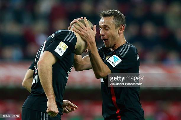 Arjen Robben of Muenchen celebrates scoring the 4th team goal with his team mate Rafinha during the Bundesliga match between FC Augsburg and FC...