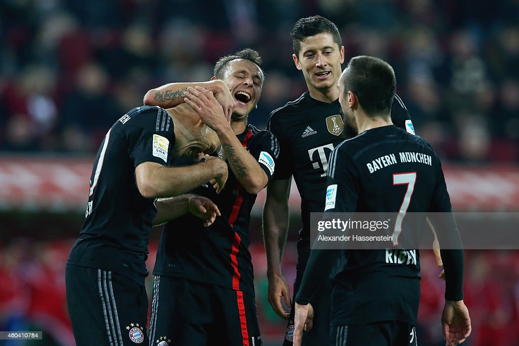 Arjen Robben of Muenchen celebrates scoring the 4th team goal with his team mate Rafinha Robert Lewandowski and Franck Ribery during the Bundesliga...