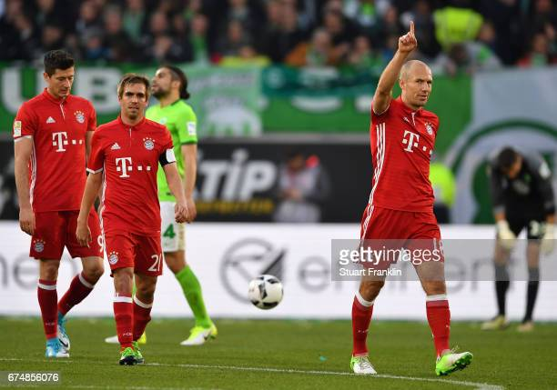 Arjen Robben of Muenchen celebrates scoring the fourth goal during the Bundesliga match between VfL Wolfsburg and Bayern Muenchen at Volkswagen Arena...