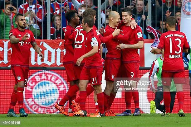 Arjen Robben of Muenchen celebrates scoring the opening goal with his team mate Robert Lewandowski during the Bundesliga match between FC Bayern...
