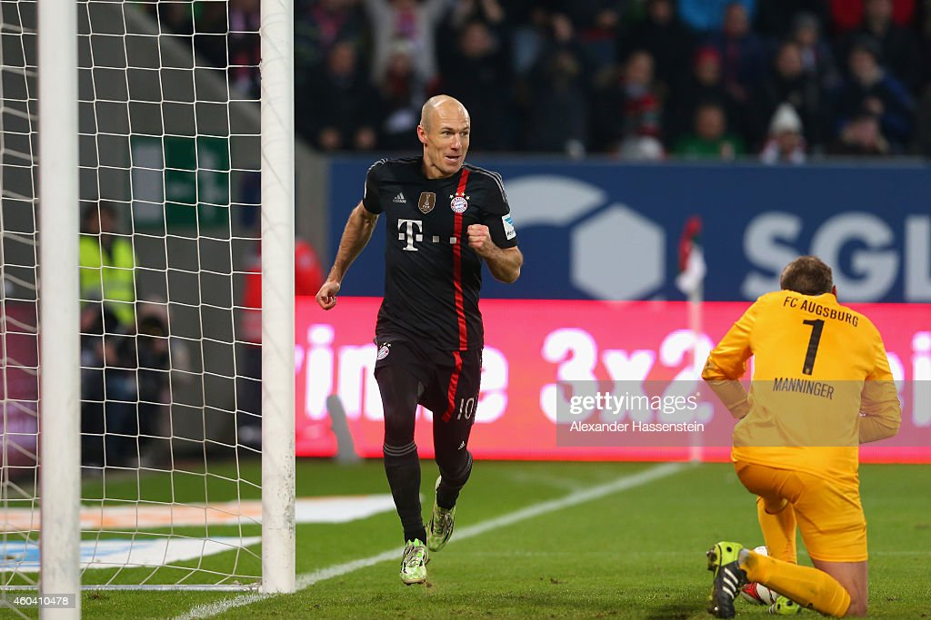 <a gi-track='captionPersonalityLinkClicked' href=/galleries/search?phrase=Arjen+Robben&family=editorial&specificpeople=194740 ng-click='$event.stopPropagation()'>Arjen Robben</a> of Muenchen celebrates scoring the second team goal whilst Augbsurgs keeper <a gi-track='captionPersonalityLinkClicked' href=/galleries/search?phrase=Alexander+Manninger&family=editorial&specificpeople=167082 ng-click='$event.stopPropagation()'>Alexander Manninger</a> looks dejected during the Bundesliga match between FC Augsburg and FC Bayern Muenchen at SGL Arena on December 13, 2014 in Augsburg, Germany.
