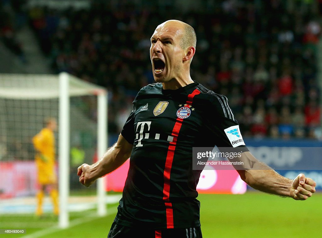 Arjen Robben of Muenchen celebrates scoring the second team goal during the Bundesliga match between FC Augsburg and FC Bayern Muenchen at SGL Arena...