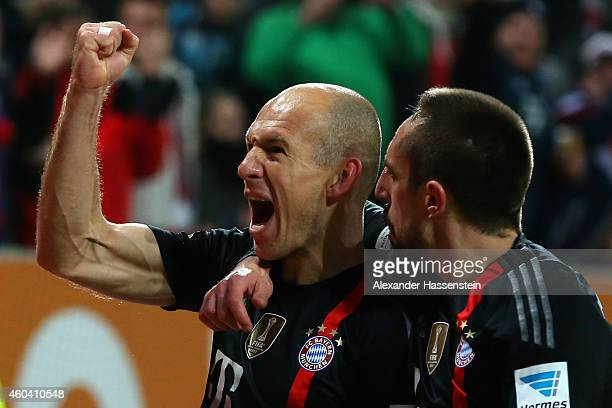 Arjen Robben of Muenchen celebrates scoring the second team goal with his team mate Franck Ribery during the Bundesliga match between FC Augsburg and...