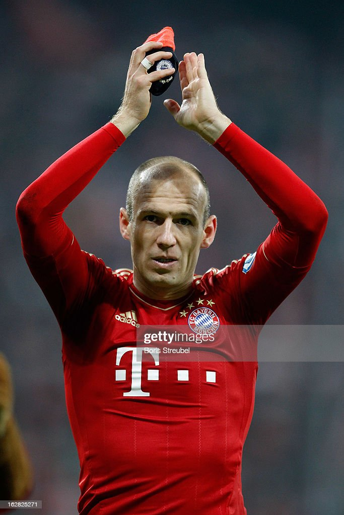 <a gi-track='captionPersonalityLinkClicked' href=/galleries/search?phrase=Arjen+Robben&family=editorial&specificpeople=194740 ng-click='$event.stopPropagation()'>Arjen Robben</a> of Muenchen celebrates the victory after the DFB Cup Quarter Final match between FC Bayern Muenchen and Borussia Dortmund at Allianz Arena on February 27, 2013 in Munich, Germany.
