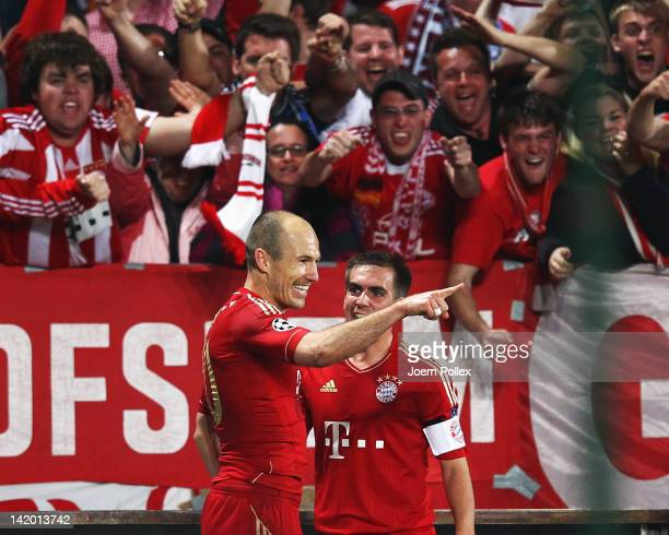 Arjen Robben of Muenchen celebrates with his team mate Philipp Lahm after scoring his team's second goal during the UEFA Champions League Quarter...