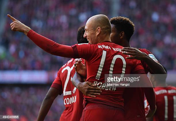 Arjen Robben of Muenchen celebrates with his teammates after scoring his team's first goal during the Bundesliga match between FC Bayern Muenchen and...