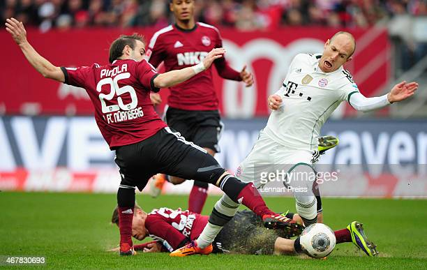 Arjen Robben of Muenchen challenges Javier Pinola and Ondrej Petrak of Nuernberg during the Bundesliga match between 1 FC Nuernberg and FC Bayern...