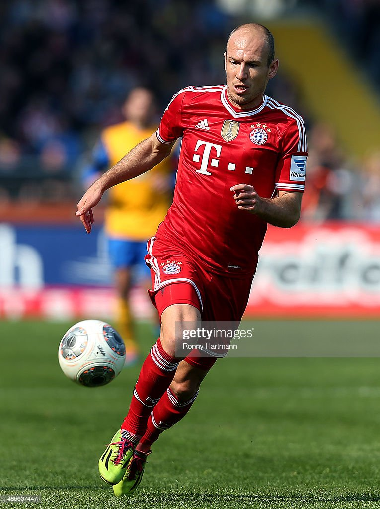<a gi-track='captionPersonalityLinkClicked' href=/galleries/search?phrase=Arjen+Robben&family=editorial&specificpeople=194740 ng-click='$event.stopPropagation()'>Arjen Robben</a> of Muenchen controls the ball during the Bundesliga match between Eintracht Braunschweig and FC Bayern Muenchen at Eintracht Stadion on April 19, 2014 in Braunschweig, Germany.