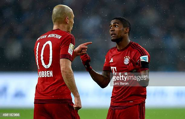 Arjen Robben of Muenchen discusses with Douglas Costa of Muenchen during the Bundesliga match between FC Schalke 04 and FC Bayern Muenchen at...