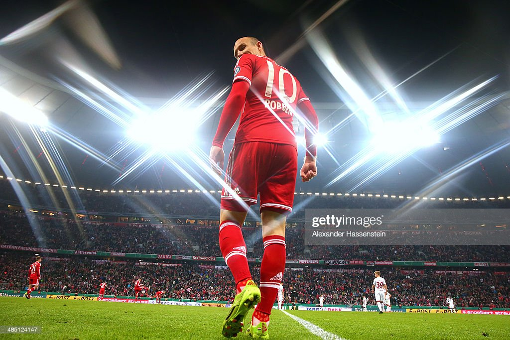 <a gi-track='captionPersonalityLinkClicked' href=/galleries/search?phrase=Arjen+Robben&family=editorial&specificpeople=194740 ng-click='$event.stopPropagation()'>Arjen Robben</a> of Muenchen enters the field for the DFB Cup semi final match between FC Bayern Muenchen and 1. FC Kaiserslautern at Allianz Arena on April 16, 2014 in Munich, Germany.