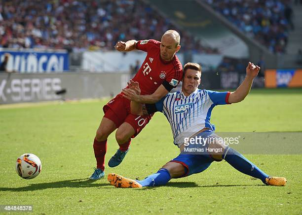 Arjen Robben of Muenchen is challenged by Fabian Schaer of Hoffenheim during the Bundesliga match between 1899 Hoffenheim and FC Bayern Muenchen at...