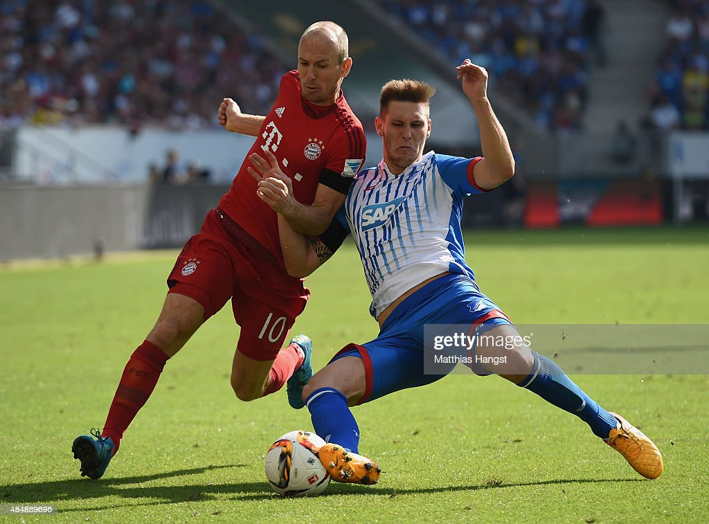 <a gi-track='captionPersonalityLinkClicked' href=/galleries/search?phrase=Arjen+Robben&family=editorial&specificpeople=194740 ng-click='$event.stopPropagation()'>Arjen Robben</a> (L) of Muenchen is challenged by Fabian Schaer of Hoffenheim during the Bundesliga match between 1899 Hoffenheim and FC Bayern Muenchen at Wirsol Rhein-Neckar-Arena on August 22, 2015 in Sinsheim, Germany.