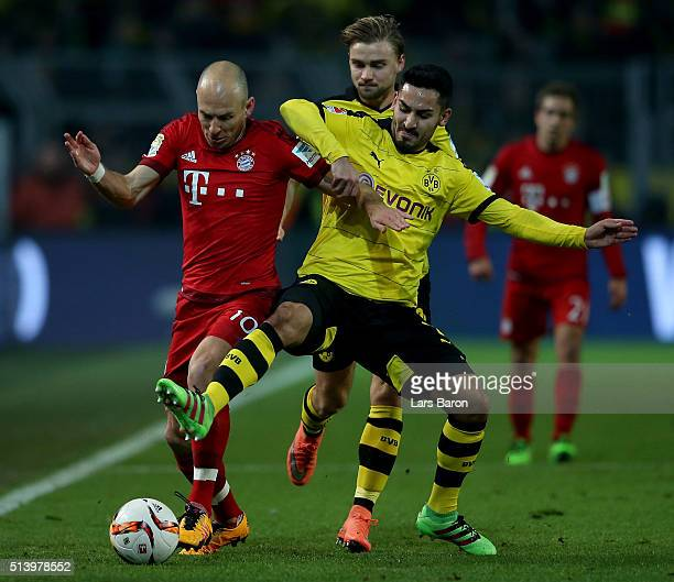 Arjen Robben of Muenchen is challenged by Ilkay Guendogan of Dortmund during the Bundesliga match between Borussia Dortmund and FC Bayern Muenchen at...