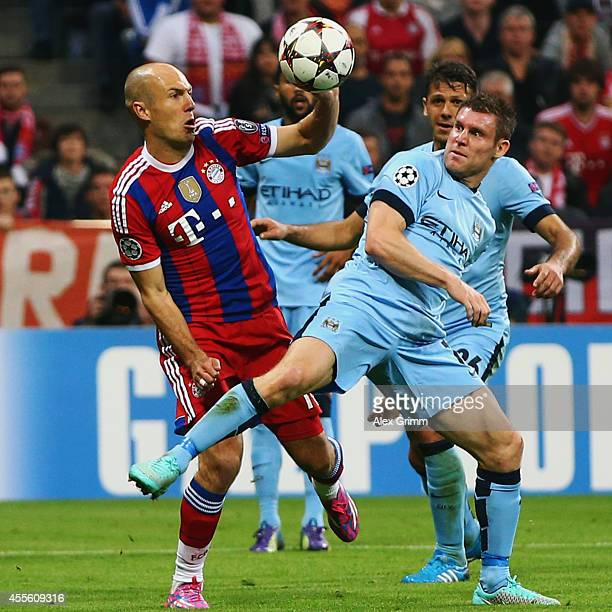 Arjen Robben of Muenchen is challenged by James Milner of Manchester during the UEFA Champions League Group E match between Bayern Munchen and...