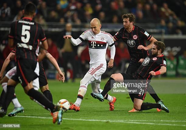 Arjen Robben of Muenchen is challenged by Marc Stendera of Frankfurt during the Bundesliga match between Eintracht Frankfurt and FC Bayern Muenchen...
