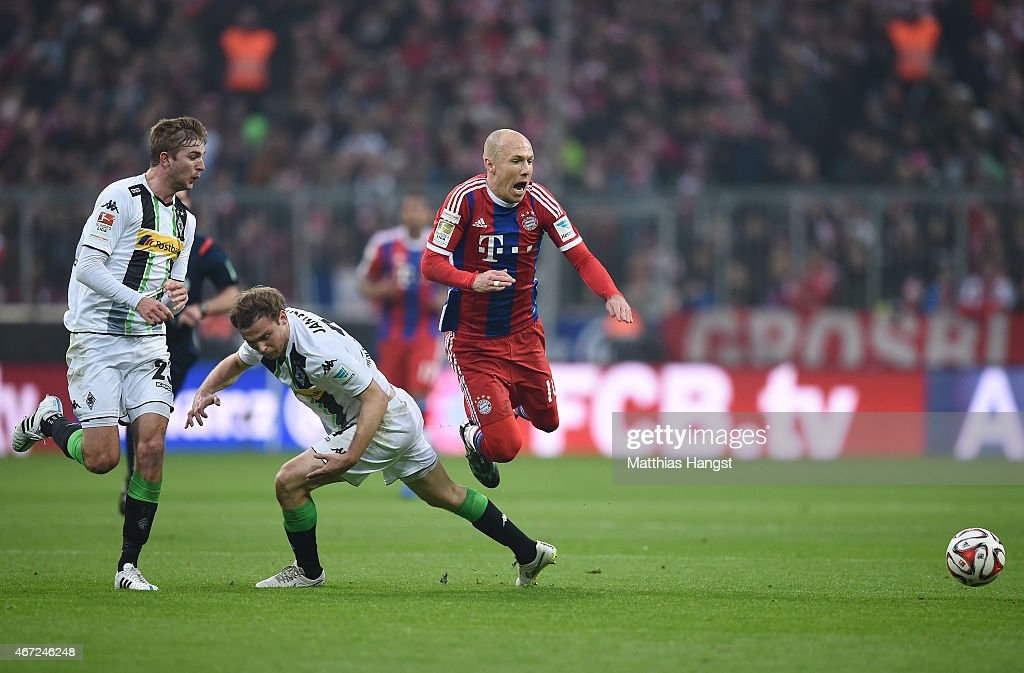 <a gi-track='captionPersonalityLinkClicked' href=/galleries/search?phrase=Arjen+Robben&family=editorial&specificpeople=194740 ng-click='$event.stopPropagation()'>Arjen Robben</a> (R) of Muenchen is fouled by <a gi-track='captionPersonalityLinkClicked' href=/galleries/search?phrase=Tony+Jantschke&family=editorial&specificpeople=4158344 ng-click='$event.stopPropagation()'>Tony Jantschke</a> (C) of Gladbach and gets injured during the Bundesliga match between FC Bayern Muenchen and Borussia Moenchengladbach at Allianz Arena on March 22, 2015 in Munich, Germany.