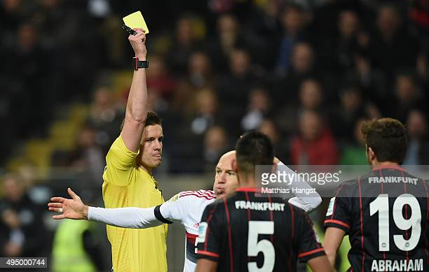 Arjen Robben of Muenchen is shown a yellow card by referee Daniel Siebert during the Bundesliga match between Eintracht Frankfurt and FC Bayern...