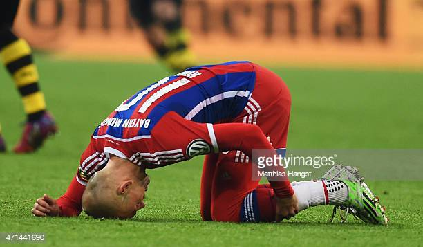 Arjen Robben of Muenchen lays injured on the pitch during the DFB Cup semi final match between FC Bayern Muenchen and Borussia Dortmund at Allianz...