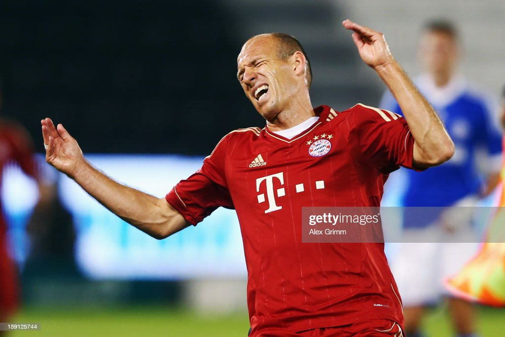 <a gi-track='captionPersonalityLinkClicked' href=/galleries/search?phrase=Arjen+Robben&family=editorial&specificpeople=194740 ng-click='$event.stopPropagation()'>Arjen Robben</a> of Muenchen reacts during the friendly match between Bayern Muenchen and FC Schalke 04 at Jassim Bin Hamad Stadium on January 8, 2013 in Doha, Qatar.