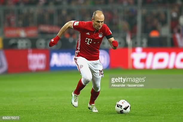 Arjen Robben of Muenchen runs with the ball during the Bundesliga match between Bayern Muenchen and RB Leipzig at Allianz Arena on December 21 2016...