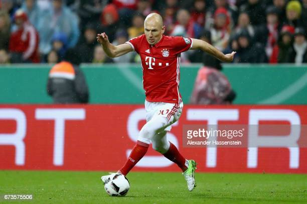 Arjen Robben of Muenchen runs with the ball during the DFB Cup semi final match between FC Bayern Muenchen and Borussia Dortmund at Allianz Arena on...