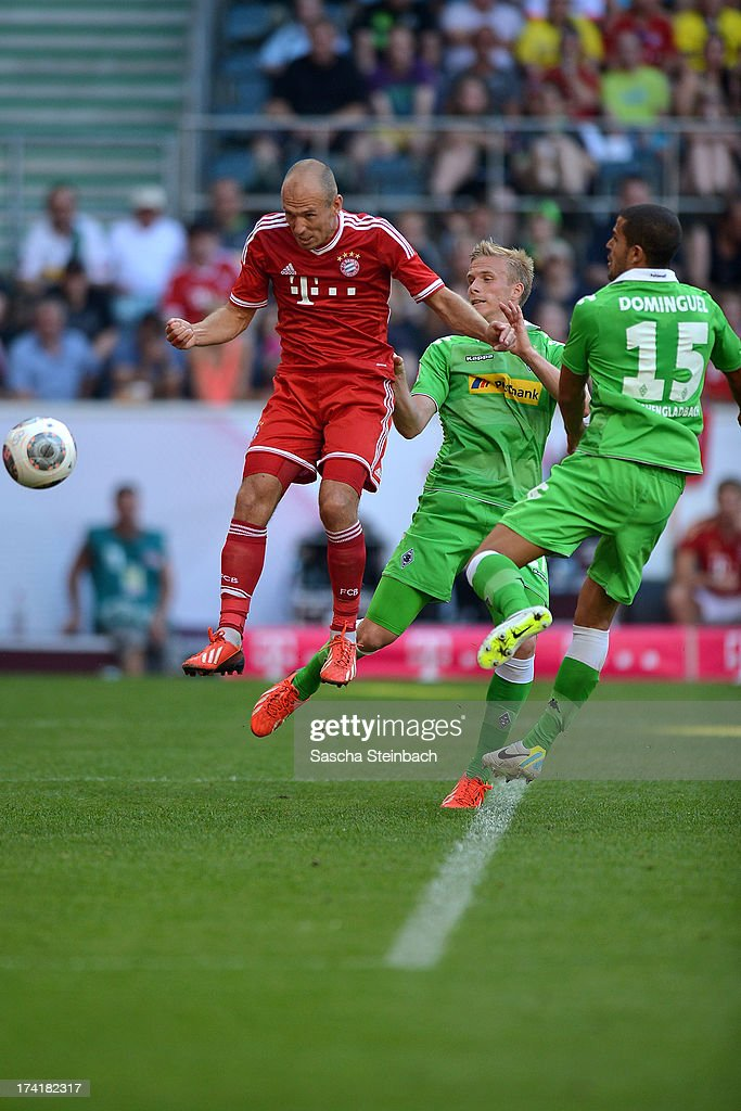 Arjen Robben (L) of Muenchen scores his team's 4th goal during the Telekom Cup 2013 final match between Borussia Moenchengladbach and FC Bayern Muenchen at Borussia-Park on July 21, 2013 in Moenchengladbach, Germany.
