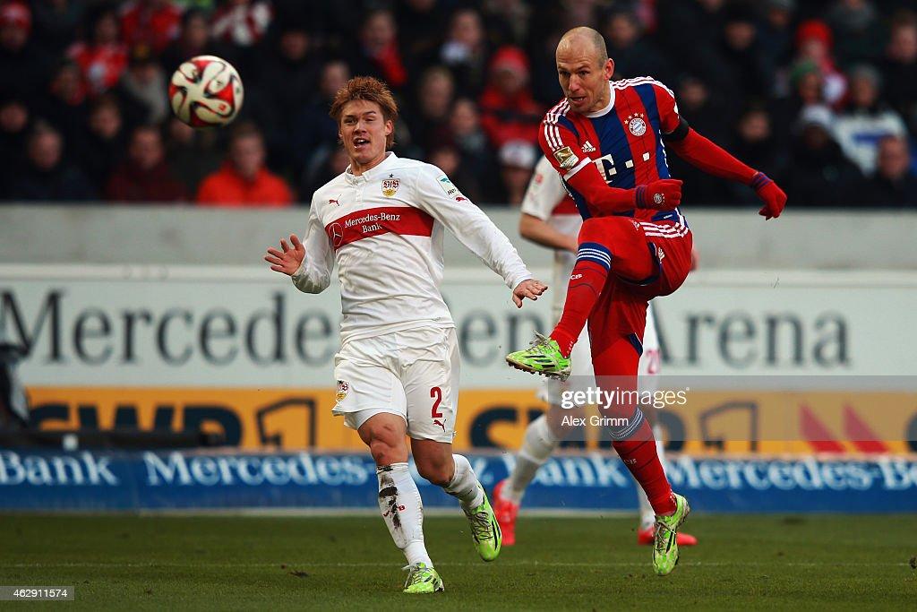 Arjen Robben of Muenchen scores his team's first goal against Gotoku Sakai of Stuttgart during the Bundesliga match between VfB Stuttgart and FC...