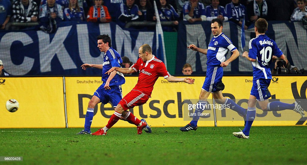<a gi-track='captionPersonalityLinkClicked' href=/galleries/search?phrase=Arjen+Robben&family=editorial&specificpeople=194740 ng-click='$event.stopPropagation()'>Arjen Robben</a> of Muenchen (2ndL) scores his team's first goal during the DFB Cup semi final match between FC Schalke 04 and FC Bayern Muenchen at Veltins Arena on March 24, 2010 in Gelsenkirchen, Germany.