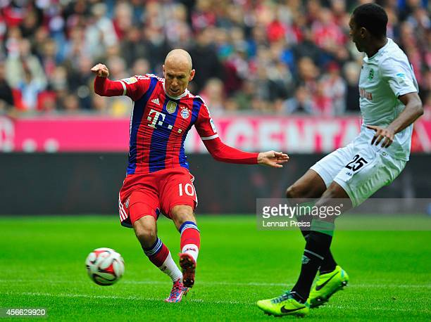 Arjen Robben of Muenchen scores his teams' second goal against Marcelo of Hannover during the Bundesliga match between FC Bayern Muenchen and...