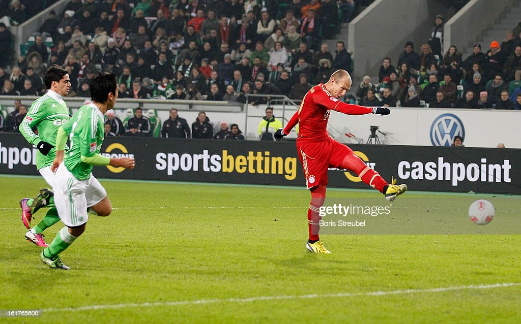 <a gi-track='captionPersonalityLinkClicked' href=/galleries/search?phrase=Arjen+Robben&family=editorial&specificpeople=194740 ng-click='$event.stopPropagation()'>Arjen Robben</a> (R) of Muenchen scores his team's second goal during the Bundesliga match between VFL Wolfsburg and FC Bayern Muenchen at Volkswagen Arena on February 15, 2013 in Wolfsburg, Germany.