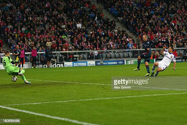 Arjen Robben of Muenchen scores his team's third goal against goalkeeper Igor Akinfeev of Moscow during the UEFA Champions League Group D match...