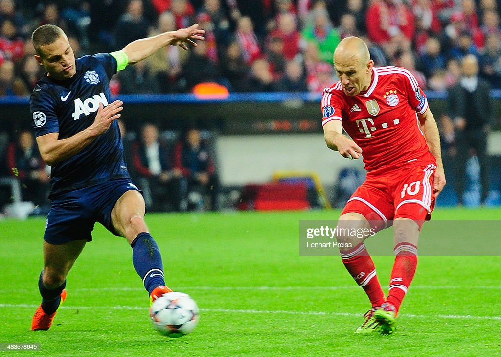 Arjen Robben (R) of Muenchen scores his teams third goal during the UEFA Champions League quarter-final second leg match between FC Bayern Muenchen and Manchester United at Allianz Arena on April 9, 2014 in Munich, Germany.