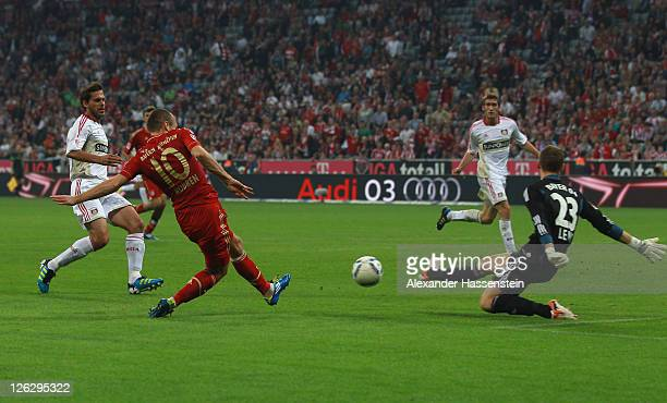 Arjen Robben of Muenchen scores the 3rd team goal during the Bundesliga match between FC Bayern Muenchen and Bayer 04 Leverkusen at Allianz Arena on...