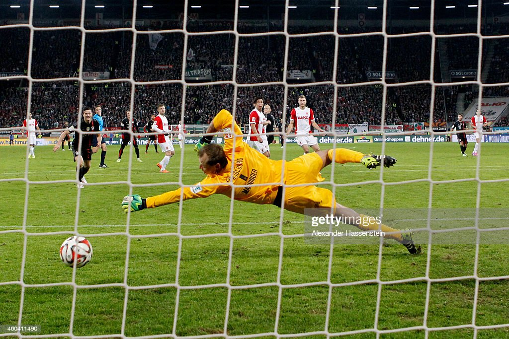 <a gi-track='captionPersonalityLinkClicked' href=/galleries/search?phrase=Arjen+Robben&family=editorial&specificpeople=194740 ng-click='$event.stopPropagation()'>Arjen Robben</a> (C) of Muenchen scores the 4th team goal against Augsburgs keeper <a gi-track='captionPersonalityLinkClicked' href=/galleries/search?phrase=Alexander+Manninger&family=editorial&specificpeople=167082 ng-click='$event.stopPropagation()'>Alexander Manninger</a> during the Bundesliga match between FC Augsburg and FC Bayern Muenchen at SGL Arena on December 13, 2014 in Augsburg, Germany.