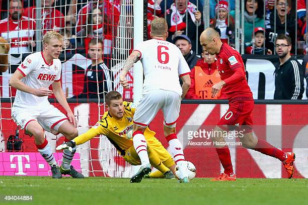 Arjen Robben of Muenchen scores the opening goal during the Bundesliga match between FC Bayern Muenchen and 1 FC Koeln at Allianz Arena on October 24...