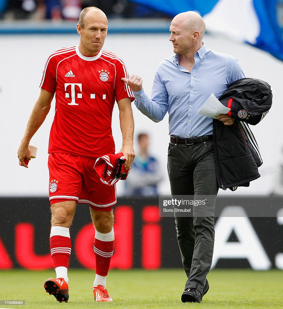 <a gi-track='captionPersonalityLinkClicked' href=/galleries/search?phrase=Arjen+Robben&family=editorial&specificpeople=194740 ng-click='$event.stopPropagation()'>Arjen Robben</a> (L) of Muenchen talks's to his manager <a gi-track='captionPersonalityLinkClicked' href=/galleries/search?phrase=Matthias+Sammer&family=editorial&specificpeople=555228 ng-click='$event.stopPropagation()'>Matthias Sammer</a> during the charity match between Hansa Rostock and FC Bayern Muenchen at DKB-Arena on July 14, 2013 in Rostock, Germany.