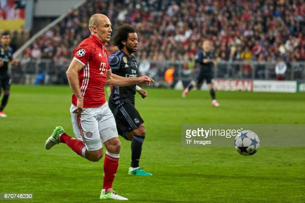 Arjen Robben of Munich and Marcelo of Real Madrid battle for the ball during the UEFA Champions League Quarter Final first leg match between FC...