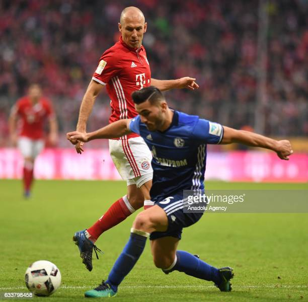 Arjen Robben of Munich and Sead Kolasinac of Schalke vie for the ball during the Bundesliga soccer match between FC Bayern Munich and FC Schalke 04...