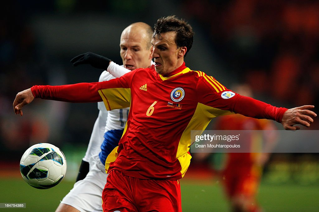 <a gi-track='captionPersonalityLinkClicked' href=/galleries/search?phrase=Arjen+Robben&family=editorial&specificpeople=194740 ng-click='$event.stopPropagation()'>Arjen Robben</a> of Netherlands and Vlad Chiriches of Romania battle for the ball during the Group 4 FIFA 2014 World Cup Qualifier match between Netherlands and Romania at Amsterdam Arena on March 26, 2013 in Amsterdam, Netherlands.